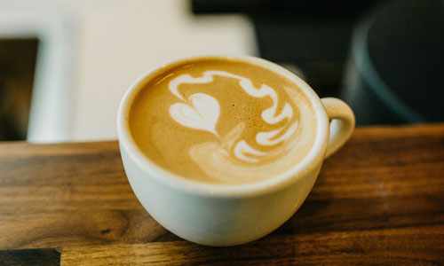 white coffee cup with heart latte art