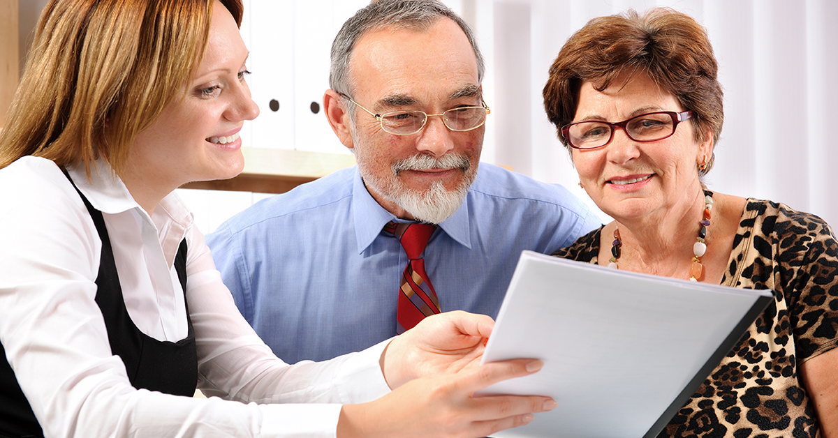 Financial advisor sitting down and going over plans with couple