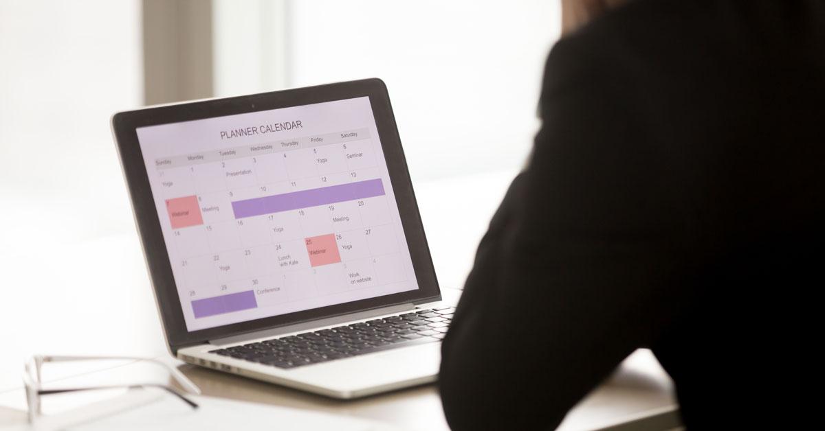 Man looking at online calendar